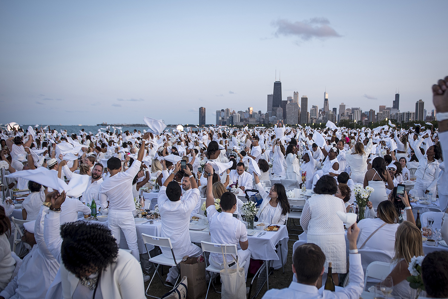 Guests attend Dinner en Blanc, a communal picnic in which attendees wear all white, in Chicago, IL on Thursday August 24, 2017. Photographer: Christopher Dilts / Sipa USA